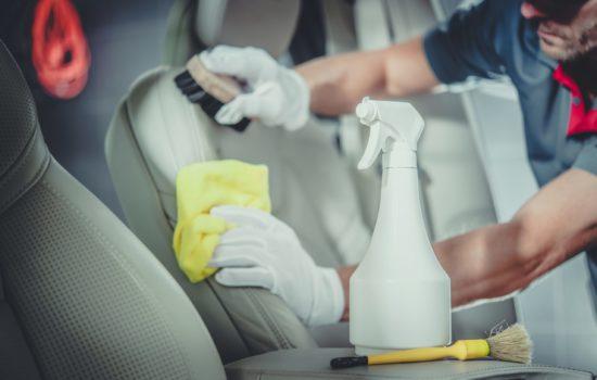 Caucasian Men Cleaning Car Interior. Professional Detailed Vehicle Maintenance.