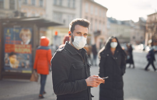 People in the city. Persons in a masks. Coronavirus theme. Couple walks during quarantine.